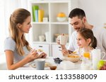 family  eating and people... | Shutterstock . vector #1133588009