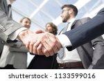 welcome and handshake business... | Shutterstock . vector #1133599016