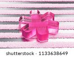 pink multiply glass icon on...