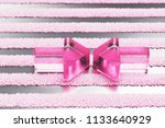 pink compress image glass icon...