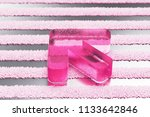 pink arrow left glass icon on...