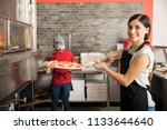 smiling chef wearing uniform... | Shutterstock . vector #1133644640