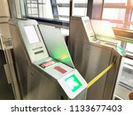 boarding pass checking machine... | Shutterstock . vector #1133677403