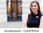 Beautiful business woman outdoors looking very happy - stock photo