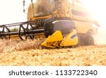 grain harvest. side view of the ... | Shutterstock . vector #1133722340