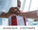 young mixed race couple getting ... | Shutterstock . vector #1133726693