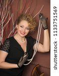 stylish blonde in a black dress ... | Shutterstock . vector #1133751569