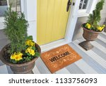 welcome door mat isolated on a... | Shutterstock . vector #1133756093