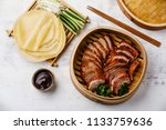 sliced peking duck in bamboo... | Shutterstock . vector #1133759636