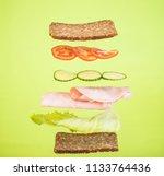 ham sandwich with levitating... | Shutterstock . vector #1133764436