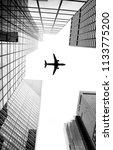 airplane flying over new york... | Shutterstock . vector #1133775200