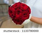 bride holding rose red wedding...