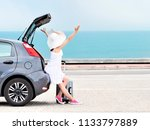 woman traveler with raised arms ... | Shutterstock . vector #1133797889