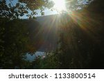 calm river in the morning sun... | Shutterstock . vector #1133800514