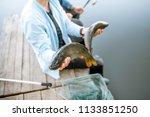 Fisherman Holding Caught Fish...