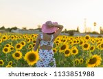 young woman in a field of... | Shutterstock . vector #1133851988