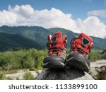 hiking boots and mountains... | Shutterstock . vector #1133899100