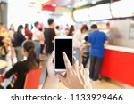 man use mobile phone  blur... | Shutterstock . vector #1133929466