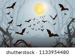 Halloween background.Spooky forest with full moon and bats flying