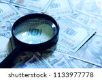 financial concept. magnifying... | Shutterstock . vector #1133977778
