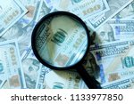 financial concept. magnifying... | Shutterstock . vector #1133977850