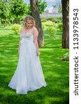 beautiful plus size bride at... | Shutterstock . vector #1133978543
