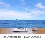 sea  sky  white clouds and... | Shutterstock . vector #1134009386