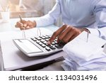 close up of a businessman... | Shutterstock . vector #1134031496