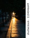 backlit people walking at... | Shutterstock . vector #1134046649
