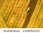 aerial top view shot of combine ... | Shutterstock . vector #1134052223