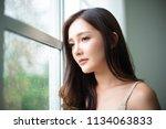 closeup thoughtful young asian... | Shutterstock . vector #1134063833