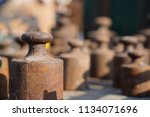 old rusty weights of different... | Shutterstock . vector #1134071696