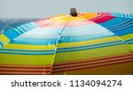 blue striped beach umbrella... | Shutterstock . vector #1134094274