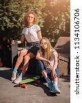 two female skaters friends... | Shutterstock . vector #1134106706