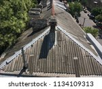old roofs of houses with... | Shutterstock . vector #1134109313