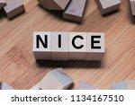 Nice Word Written In Wooden Cube