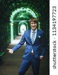 bridegroom during a wedding walk | Shutterstock . vector #1134197723
