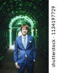 bridegroom during a wedding walk | Shutterstock . vector #1134197729