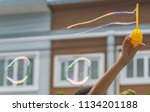 making bubbles  with house in...   Shutterstock . vector #1134201188