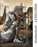 Female Warrior Knight Kneeling...