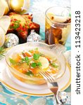 bowl of carp in jelly with carrot and parsley as traditional polish dish on christmas table - stock photo