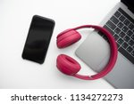 flay lay of pink headphone ... | Shutterstock . vector #1134272273