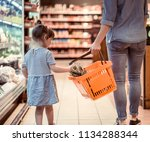 mom and daughter are shopping... | Shutterstock . vector #1134288344