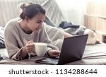 girl at home at computer ... | Shutterstock . vector #1134288644