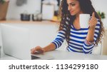 smiling young woman with coffee ... | Shutterstock . vector #1134299180