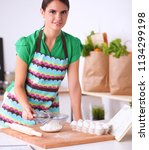 woman is making cakes in the... | Shutterstock . vector #1134299198