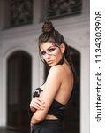 pretty girl  posing with bright ...   Shutterstock . vector #1134303908