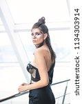 pretty model standing  posing...   Shutterstock . vector #1134303914