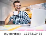 happy designer drinking coffee... | Shutterstock . vector #1134313496