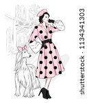 a tall slim girl in coats and...   Shutterstock .eps vector #1134341303